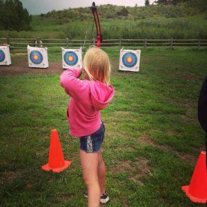 Girl learning Archery