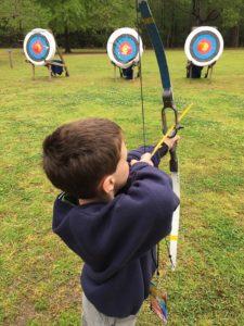 Kid learning archery