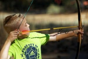 kid with bow and arrow